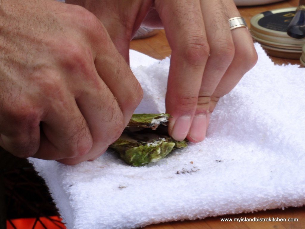 The Skillful Hands of Chef Michael Smith Shucking an Oyster