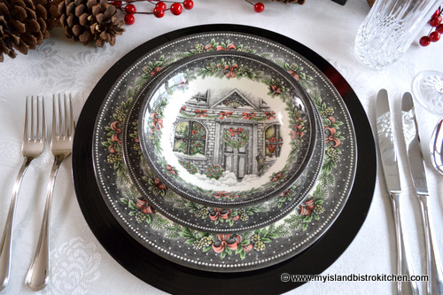the predominant blackgray color may not be what one would think of first for christmas dinnerware however look closer and you can see the blackgray