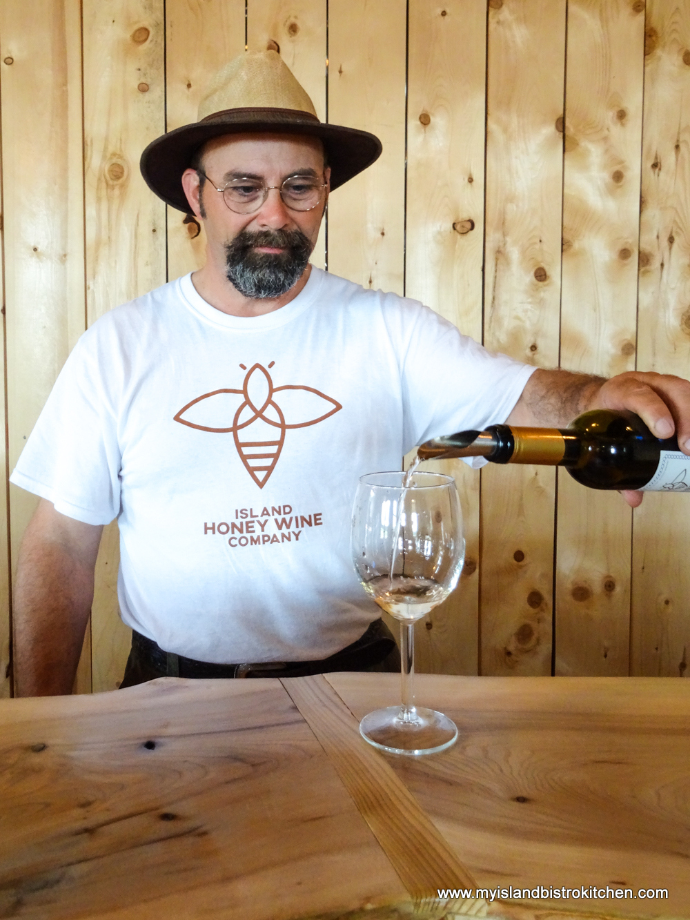Charles Lipnicki pours a sample of one of his honey meads made at Island Honey Wine Company in Wheatley River, PEI