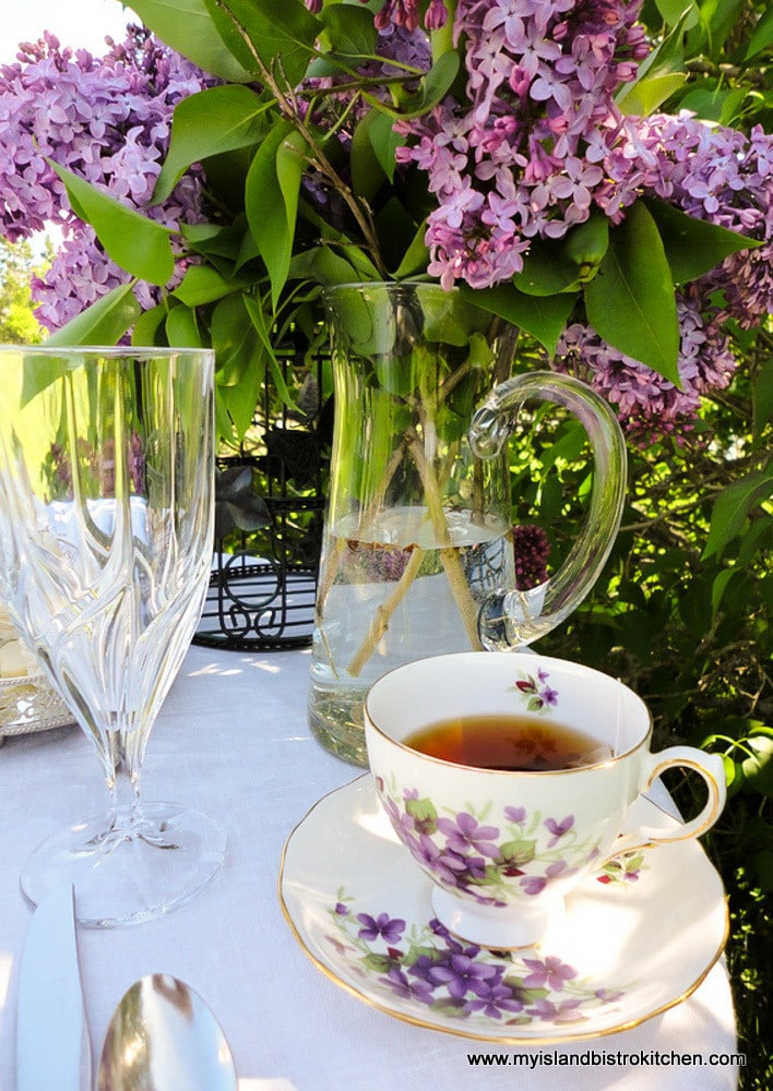 Cup of tea in front of the lilac tree