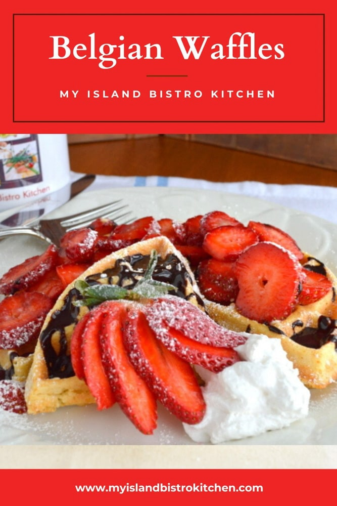 Puffy Belgian Waffles topped with fresh strawberries, whipped cream, and a dollop of rich chocolate syrup
