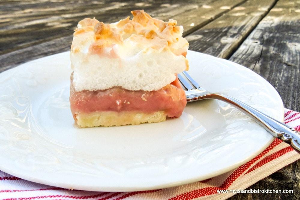 Slice of Rhubarb Custard Torte on white plate