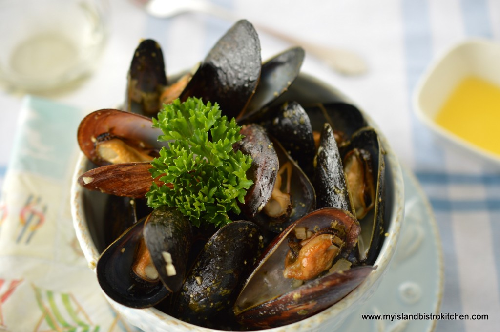 PEI mussels steamed in basil pesto with white wine, onion, and garlic