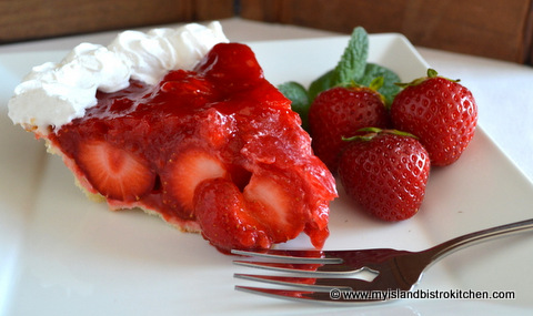 Slice of bright red strawberry pie