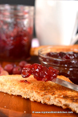 A dollop of red colored Gooseberry Jam on toast
