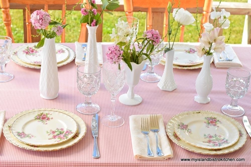 "Multiple Vases in ""S"" Pattern in Table Center"