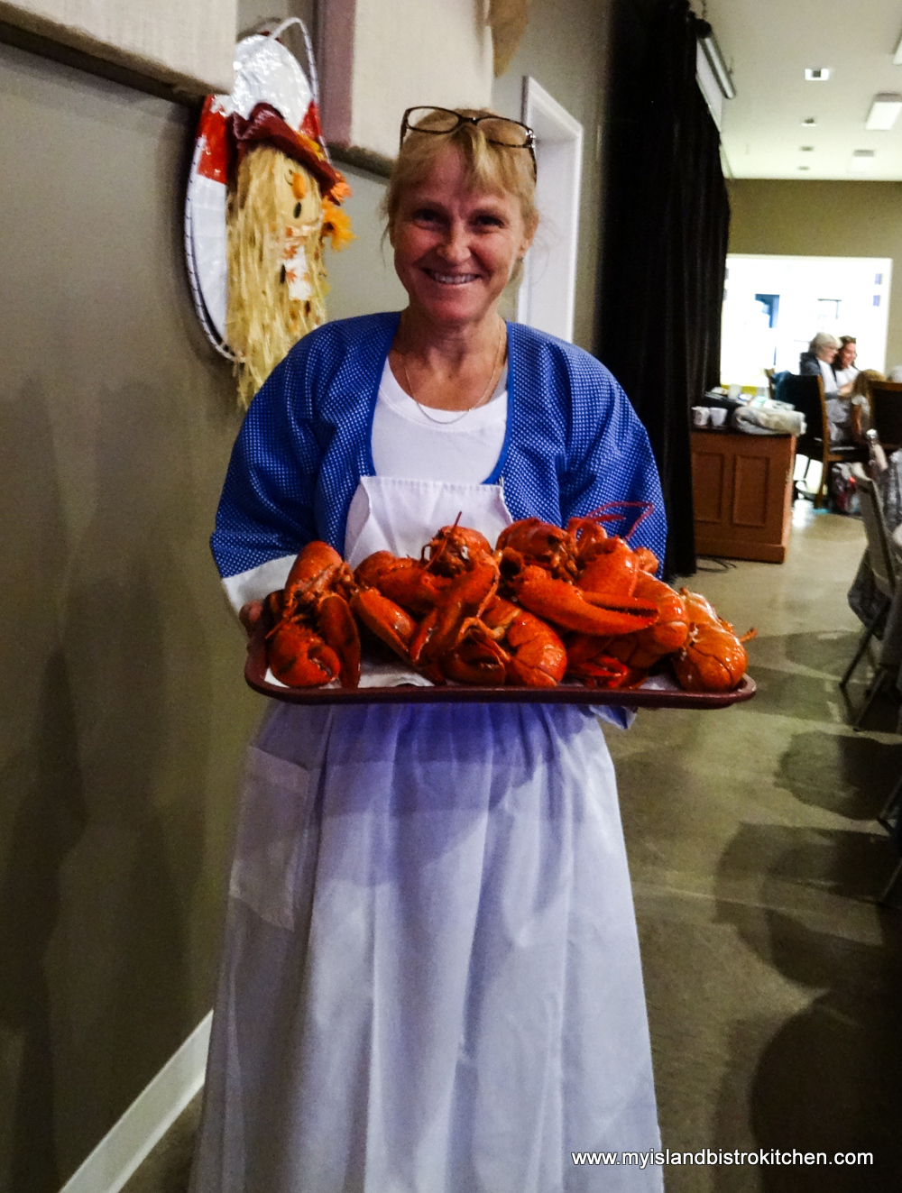 Server Arrives at Table with Platter of PEI Lobster (at the Le Festin acadien avec homard event, PEI Fall Flavours Festival 2017)