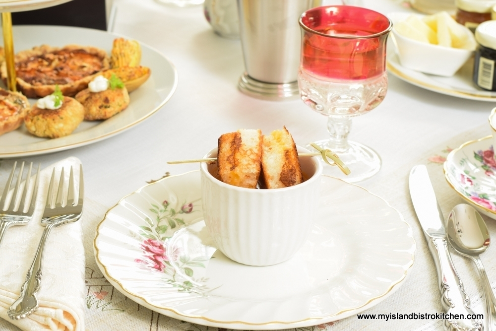 Cup of Cream of Roasted Tomato Soup with Grilled Cheese Squares