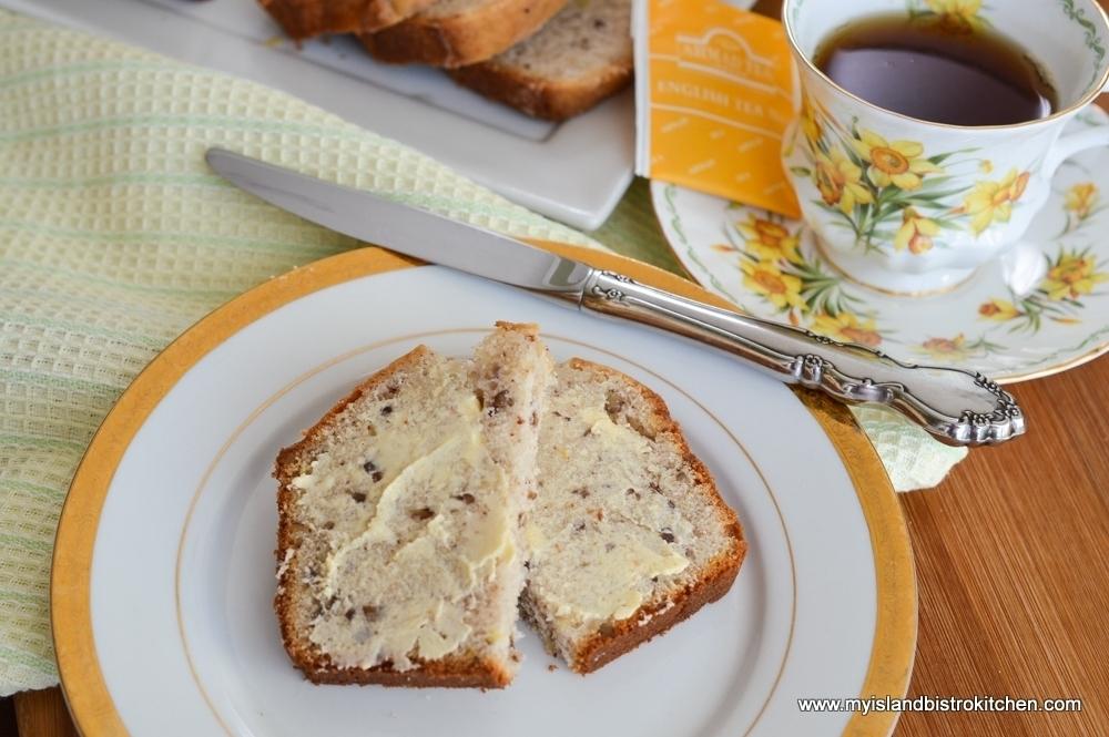 Buttered Slice of Glazed Lemon Pecan Sweet Bread