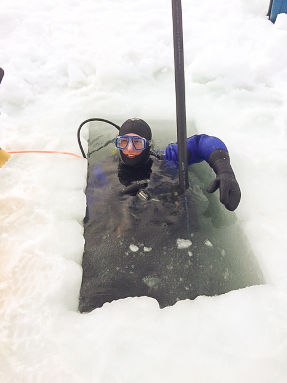 Diving Under the Ice to Retrieve Oyster Cages Sunk for the Winter (Photo Submitted by James Power, Raspberry Point Oyster Co.)