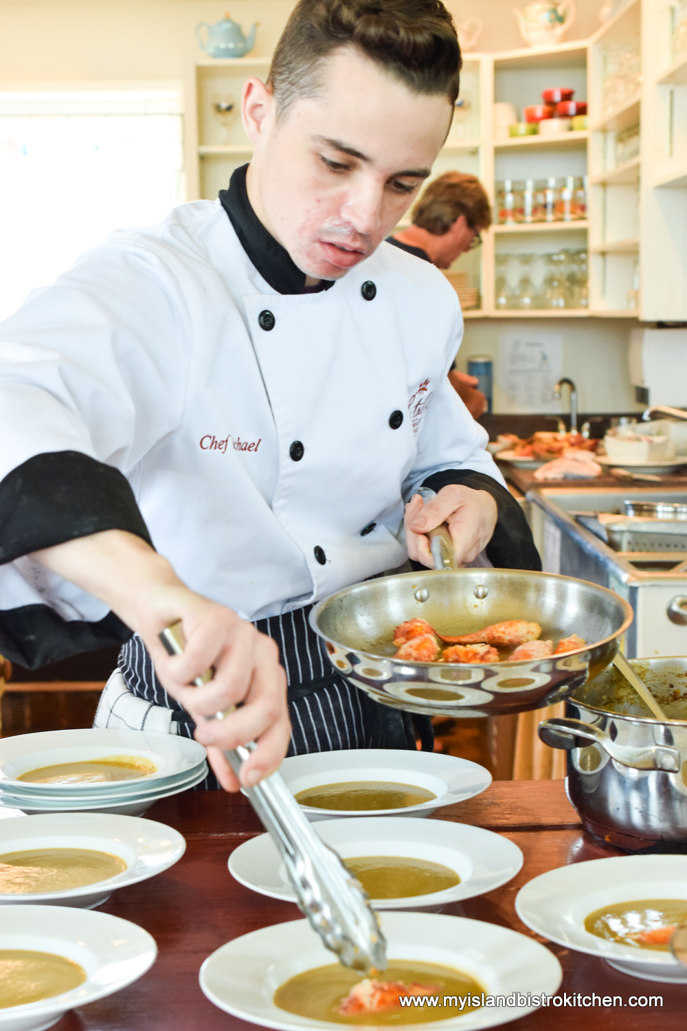 Chef Michael Bradley of The Table Culinary Studio Preparing the Lobster Bisque for Serving