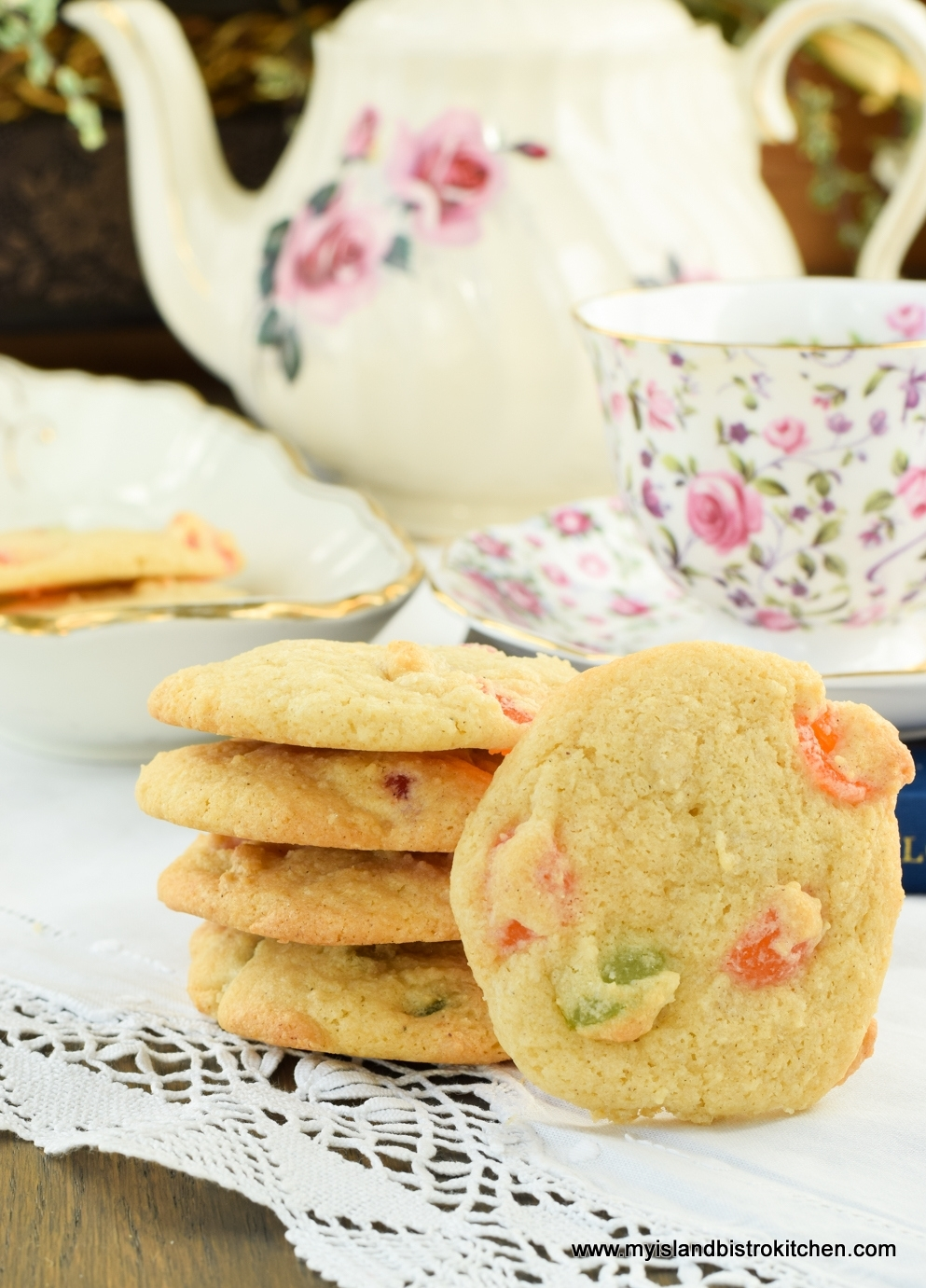 Five Gumdrop Cookies in front of a china tea pot and a pink and purple china cup and saucer