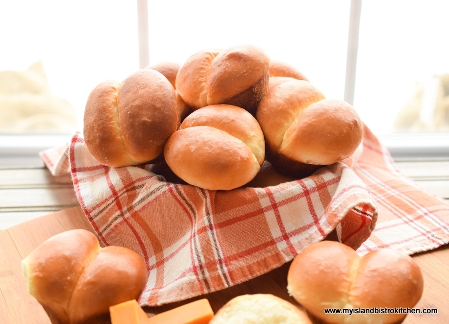 Cloth-lined basket filled with huge puffy dinner rolls