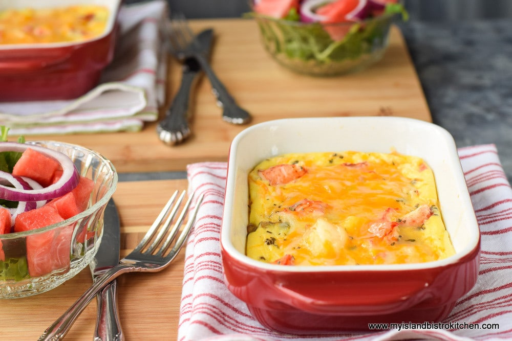 Baked lobster frittata with a side salad and a glass of white wine