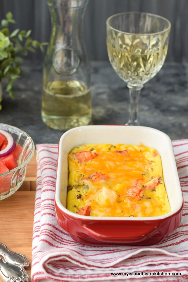 Red baking dish filled with baked lobster frittata