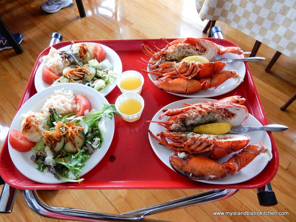 Plates of lobster and salad at New Glasgow Lobster Suppers