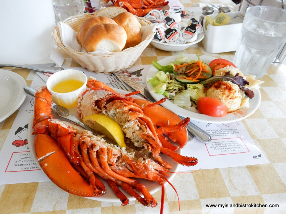 Lobster, rolls, and salad plate at New Glasgow Lobster Suppers