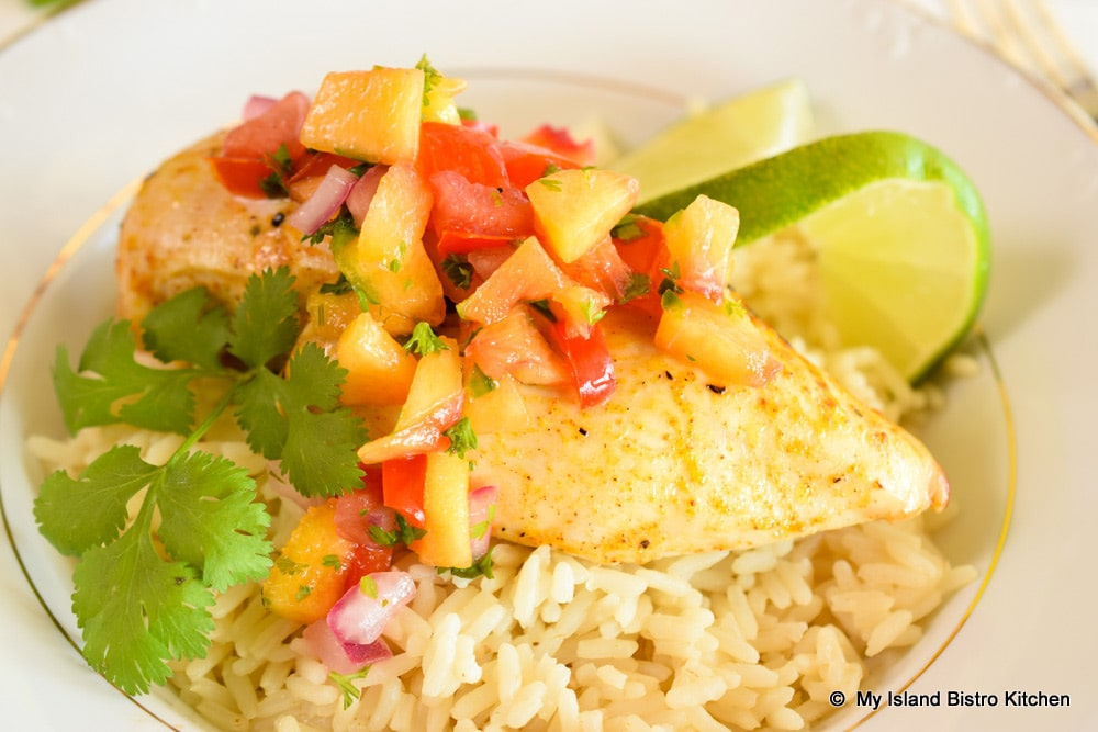 Fresh Peach Salsa tops Roasted Chicken Breast served on a bed of rice