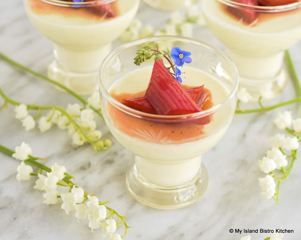 Dessert glasses filled with Panna Cotta topped with Roasted Rhubarb