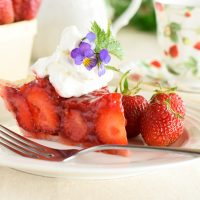 Slice of Strawberry Pie Topped with Whipped Cream