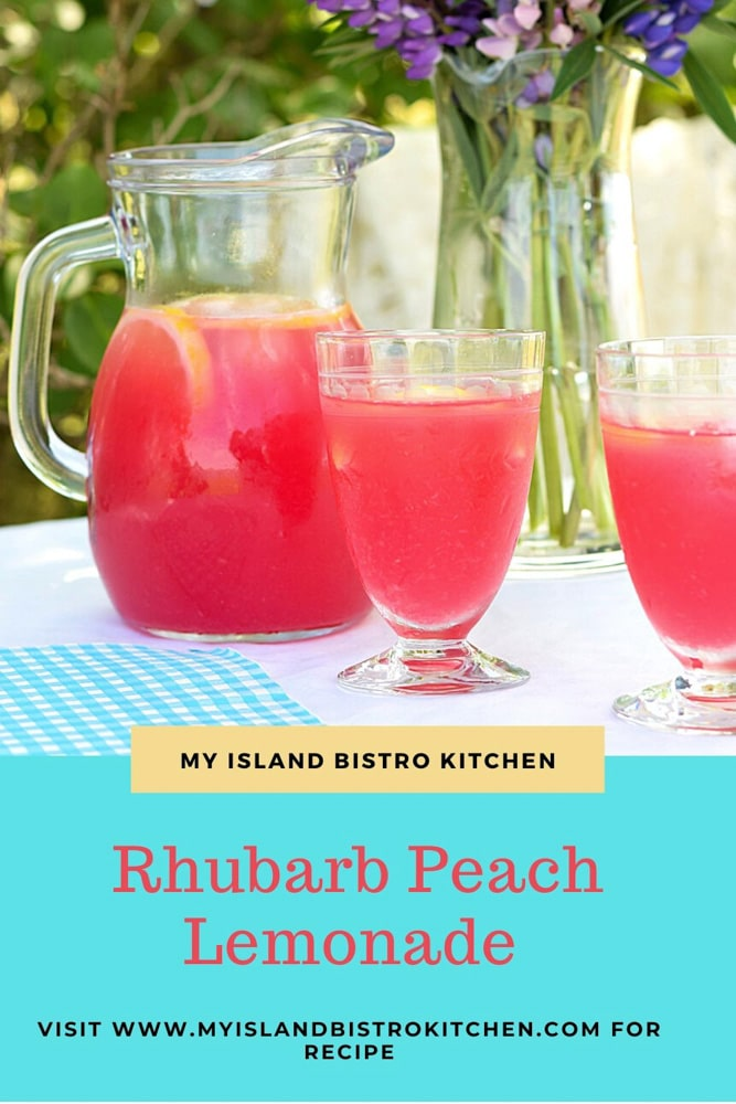 Pitcher and two glasses of rosy lemonade on table
