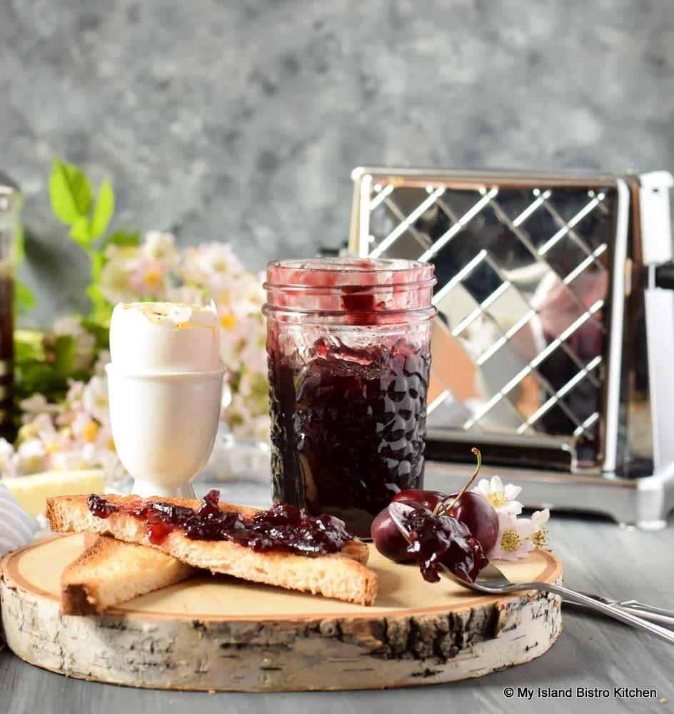 Breakfast of boiled egg and homemade cherry jam on toast