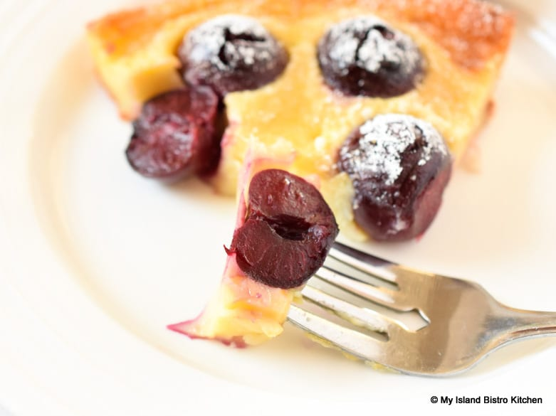 Bite of Cherry Clafoutis on a fork