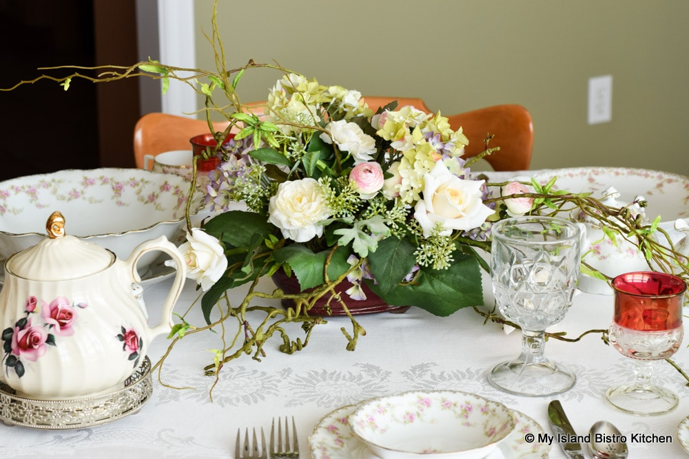 Pink, white, and green, floral centerpiece for the tea table