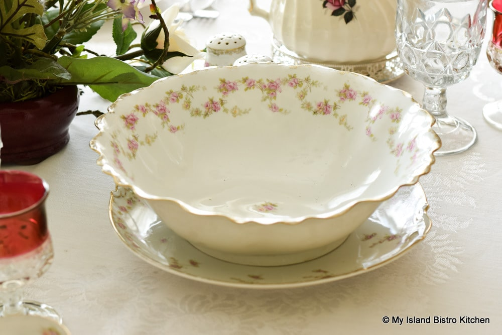 Large white serving bowl with a border of pink roses and pale greenery from a MZ Austria set of dishes