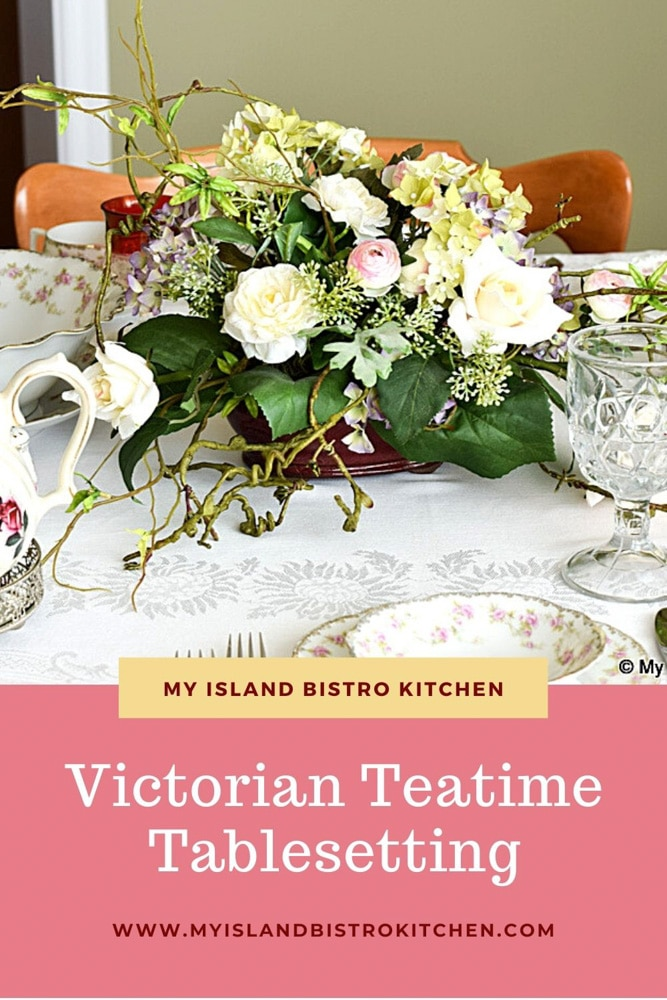 A table set with pink and white Victorian teaset