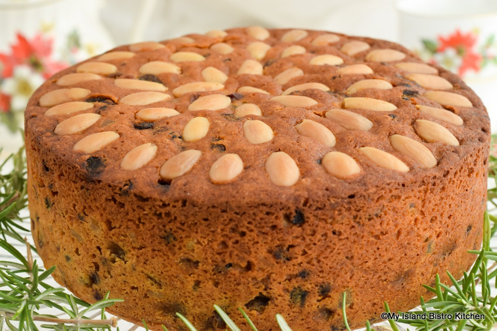 Concentric circles of almonds stud top of Dundee Cake