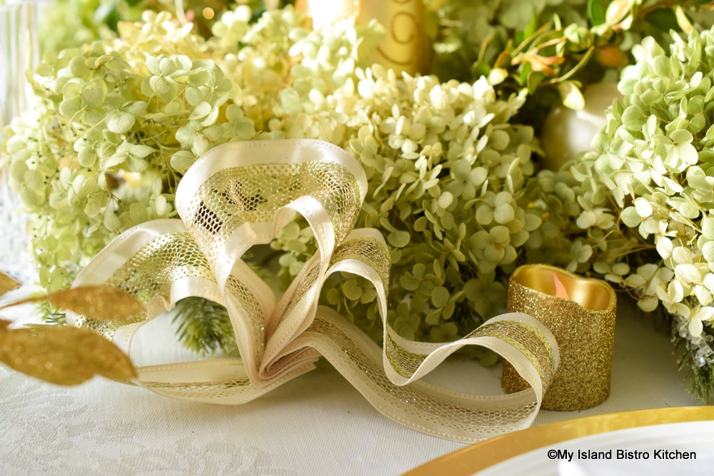 Wire-edged gold and ivory ribbon bows