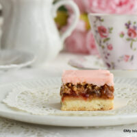 A slice of Dream Square with a cup of tea
