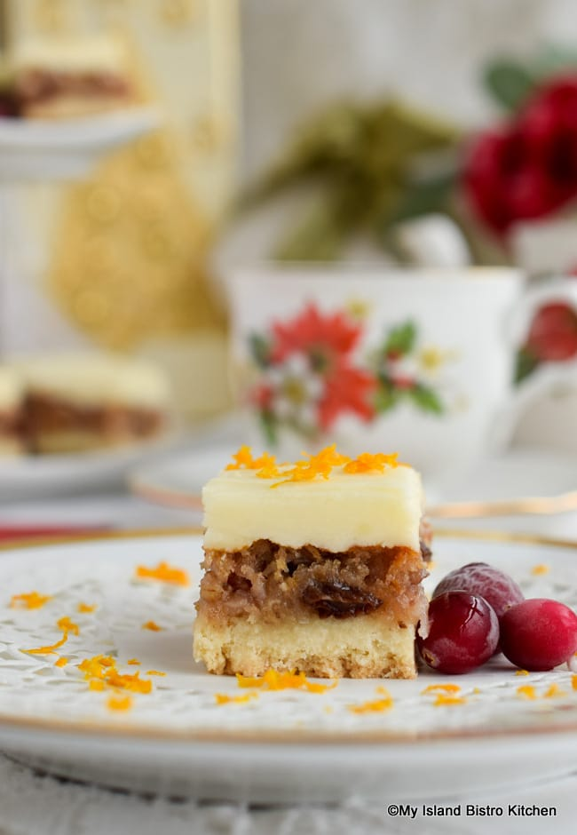 Piece of Cranberry Shortbread Square with a Christmas teacup in background