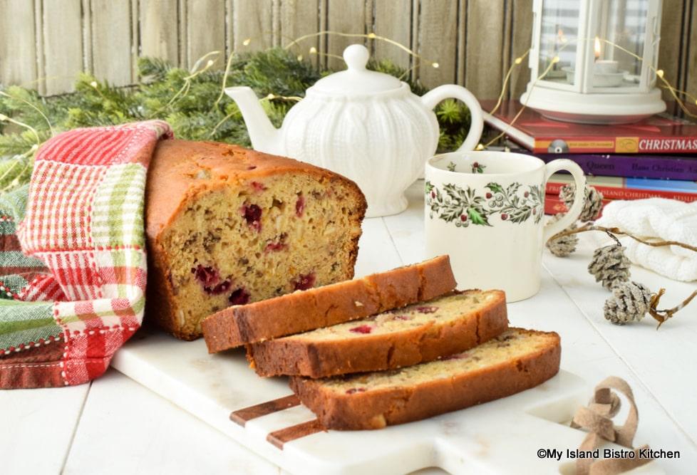 Slices of Cranberry Orange Eggnog Loaf ready for teatime