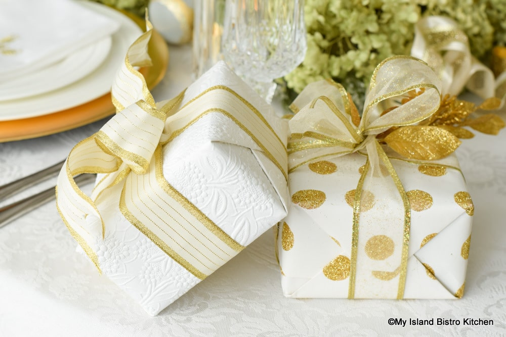 Gold and white gift-wrapped packages