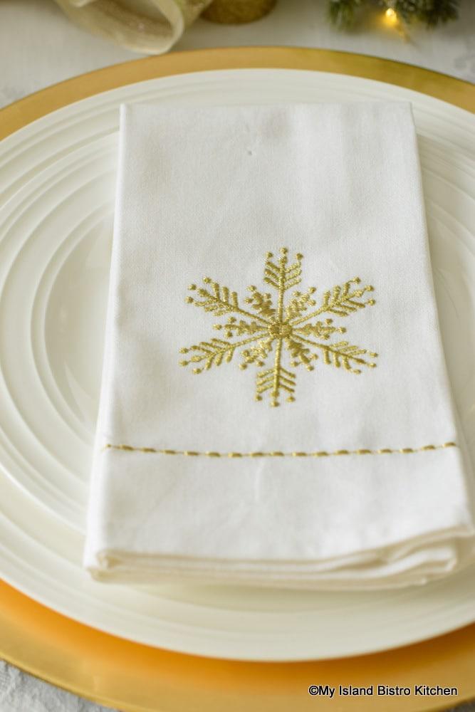 Gold Snowflake Motif on White Napkin