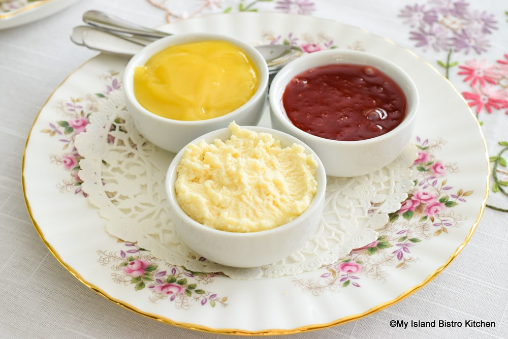 Jam, curd, and clotted cream to serve with scones