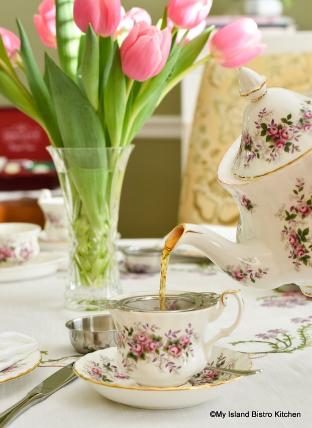 Tea is poured from a Royal Albert teapot
