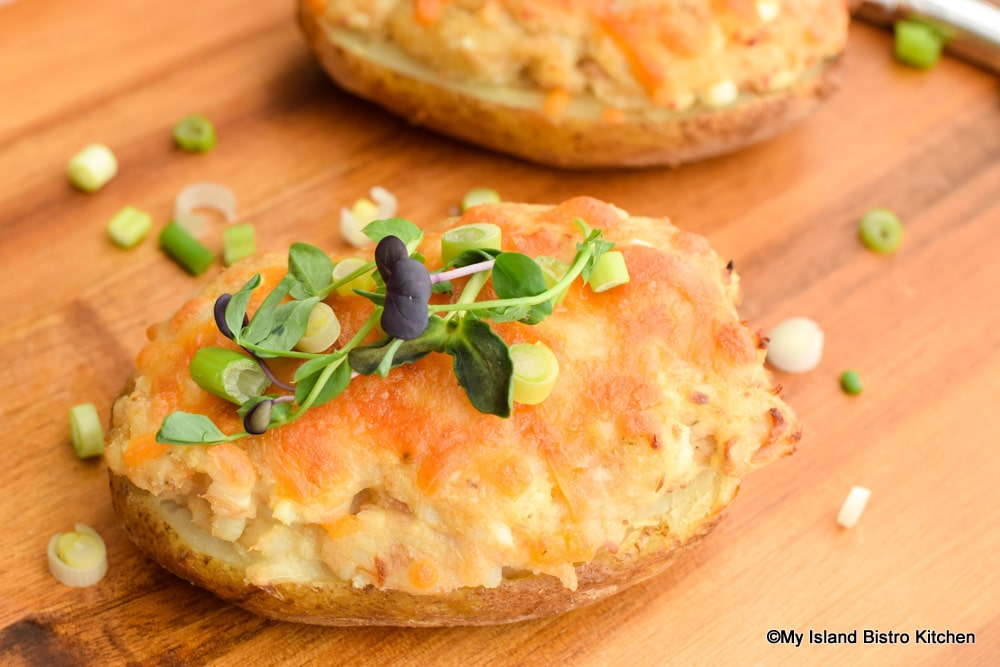 Hearty twice-baked potatoes topped with sliced green onions and pea shoots