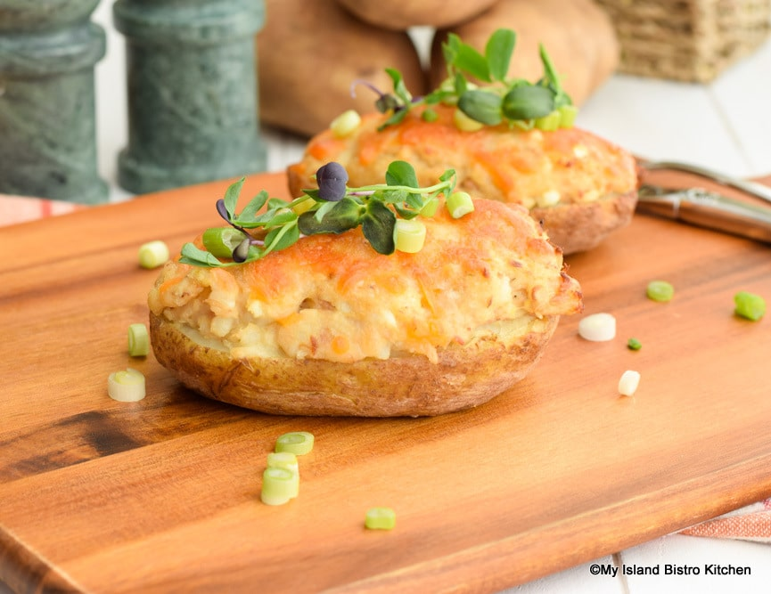 Twice-baked potatoes topped with melted cheese and pea shoots
