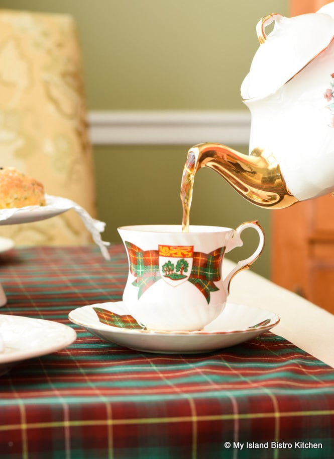 Tea being poured into an Elizabethan PEI Commemorative Teacup