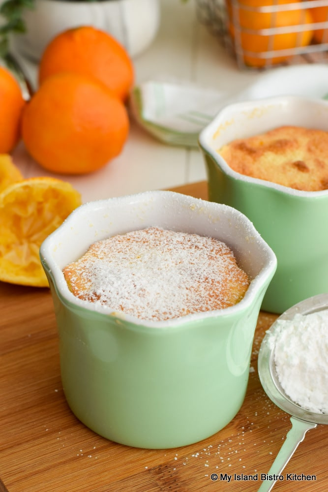 Single-serving Sponge Pudding made with clementines and dusted with icing sugar