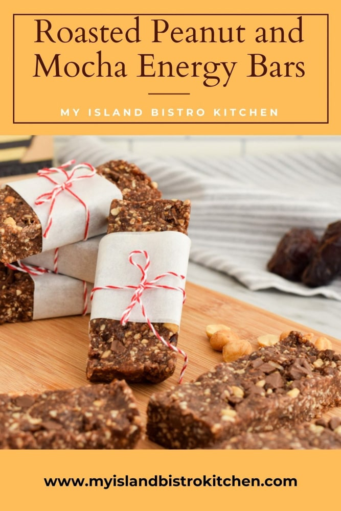 Snack bars wrapped in parchment paper on cutting board
