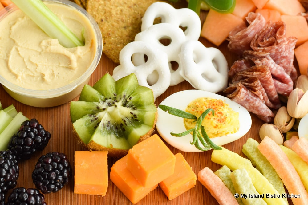 Yogurt-covered pretzels, kiwi, deviled eggs, and cheddar cheese bring out the St. Patrick's Day colors on a grazing board