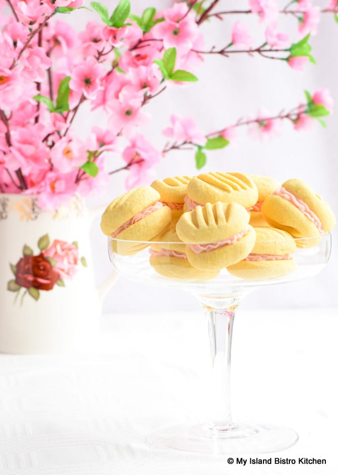 Pedestal Glass Dish Filled with Pretty Sandwich Cookies