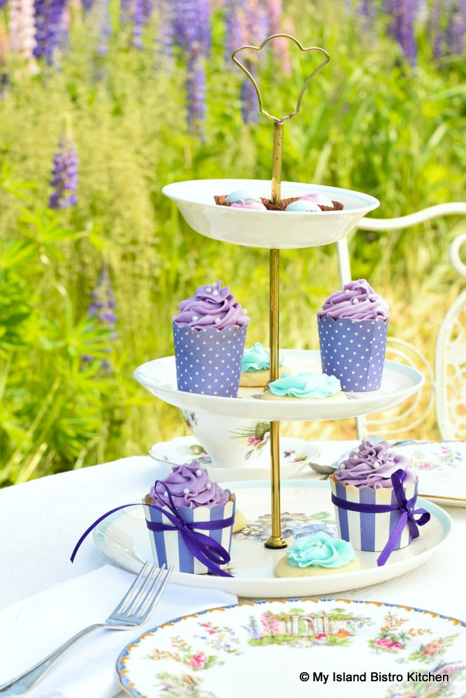 Three-tiered server with cupcakes and cookies