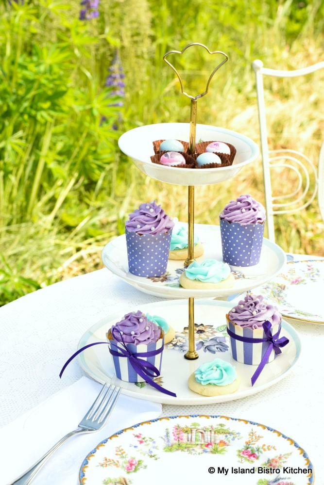 Tiered server with cupcakes, cookies, and chocolates
