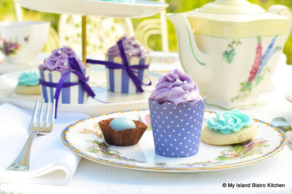 Pretty cupcakes, cookies and chocolates on tea table