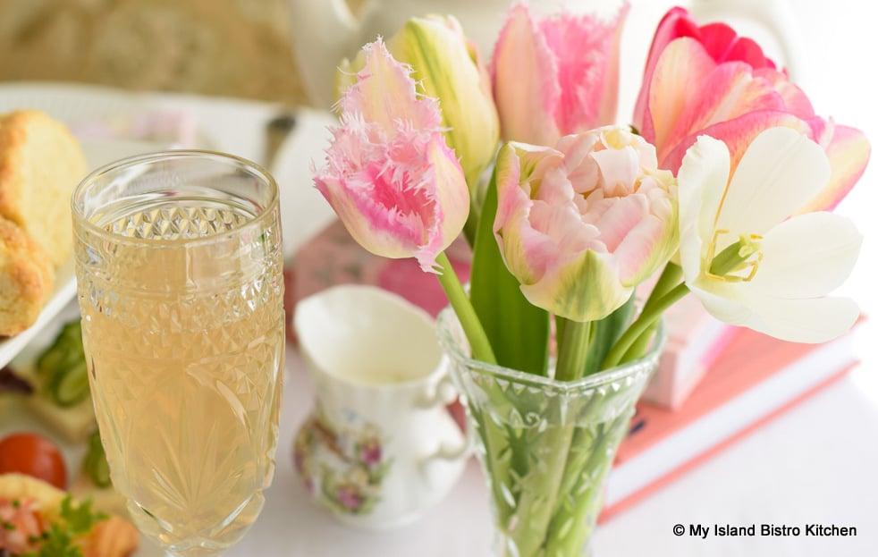 Tulips in vase on tea table
